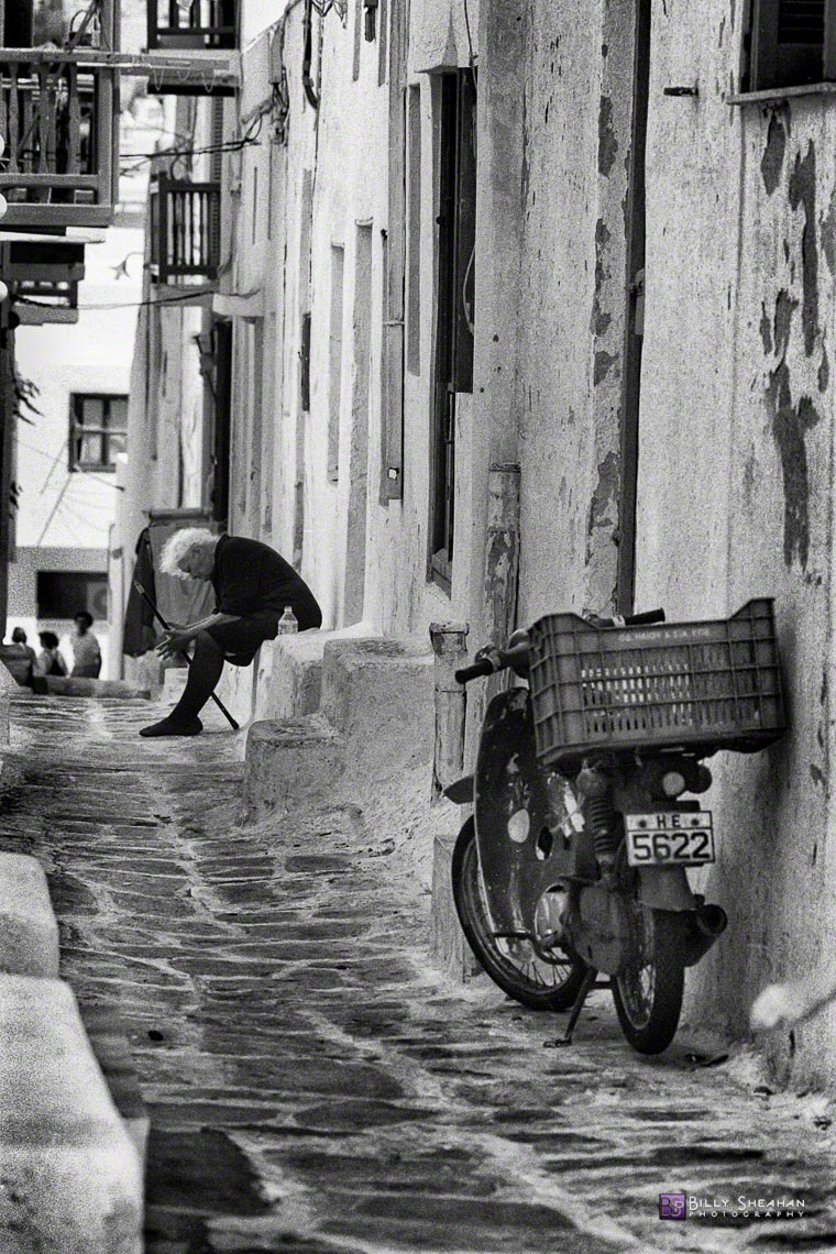 Old_Woman_on_Mykonos_Street,_Greece_Greece-321_25_BW_D