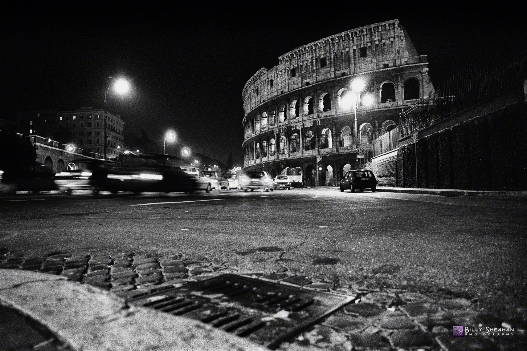 Sewer_grate__Street_and_Coloseum__Rome__Italy_Italy-127_18_BW_D