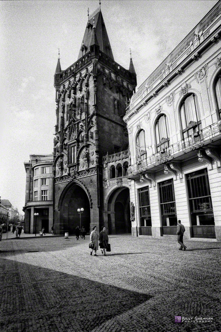 Women_walking_near_Prasna_brana_(Powder_Tower),_Prague,_Czech_Republic_Prague-644_14_BW_D